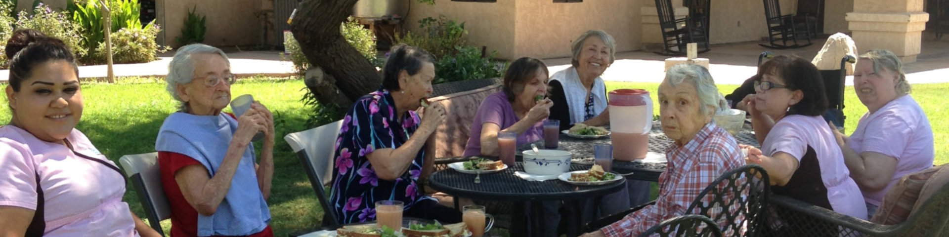 elderly ladies eating outdoors